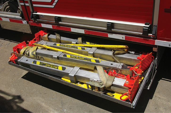 Summit Fire Apparatus built this sliding drawer holding Res-Q-Jack units low on the chassis of a USAR truck.