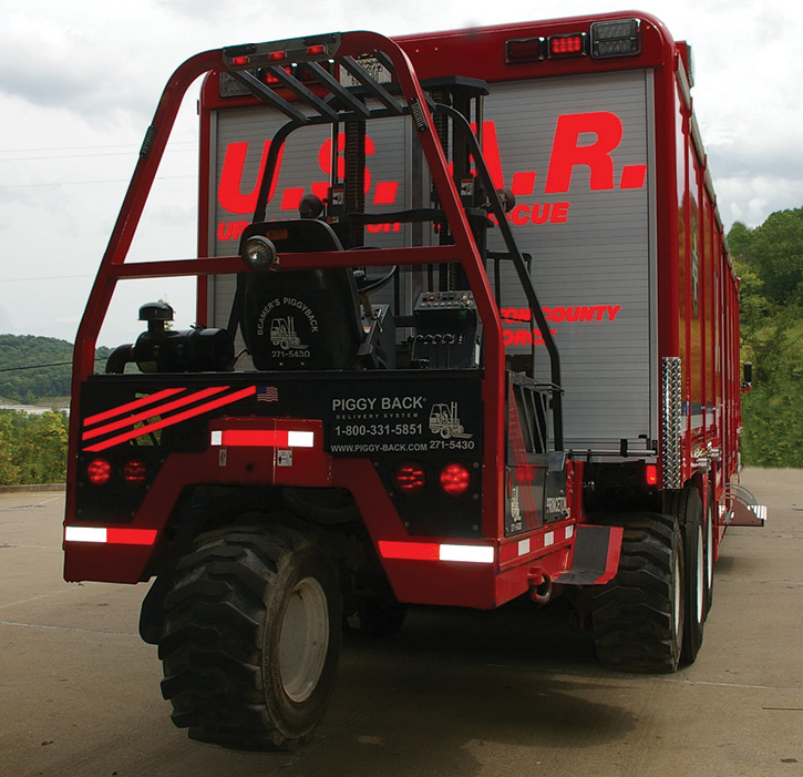 This Cincinnati (OH) USAR Team truck built by Summit Fire Apparatus hauls a trailer-mounted fork lift to handle the team's equipment and lumber-filled totes.