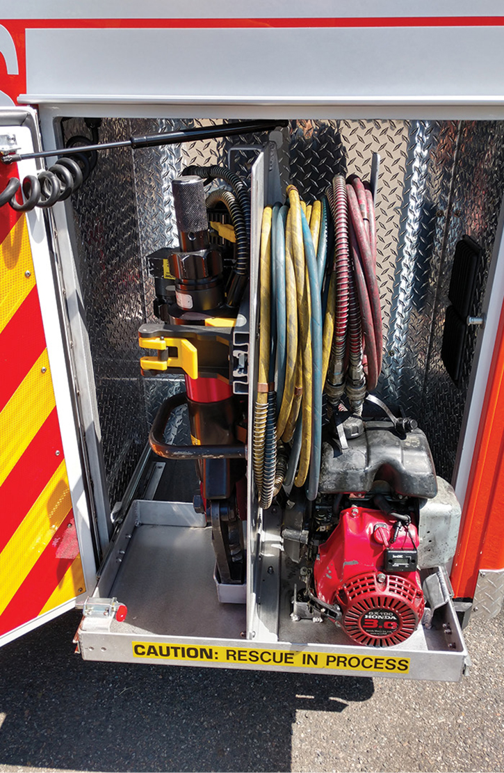 PL Custom designed a compartment on the left side of the rig to carry the squad's TNT Rescue combi tool, ram, and power unit.