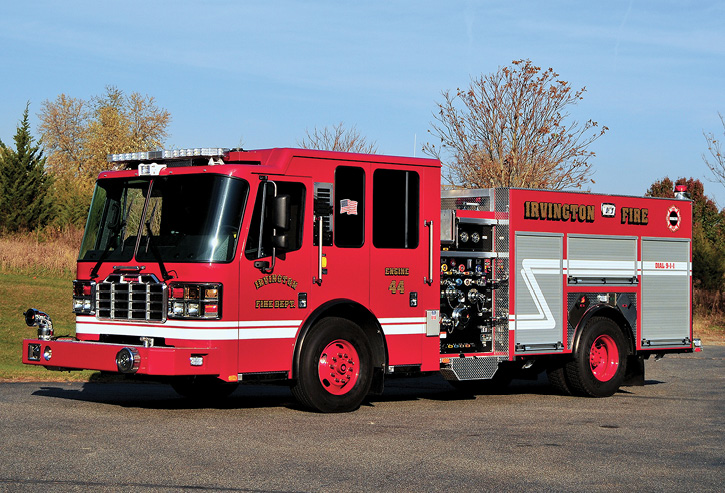 This Irvington, New Jersey, rig has a flat cab, all-red paint job, painted red wheels, and a painted bumper. It also has double high side compartments with slide-in ladder storage, a 1,500-gpm pump, and a 500-gallon tank.