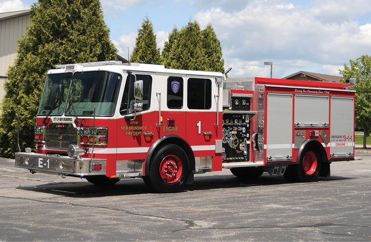 """The New Brunswick (NJ) Fire Department's rig has a 1,750-gpm pump and a 500-gallon booster tank with high left- and low right-side compartmentation. It has three rear 2½-inch discharges. Like many """"hose-conscious"""" engine companies, Engine 1 carries high-rise packs above the right-side compartments beneath the side-hung ground ladders."""