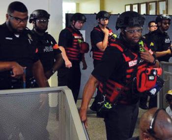 Dallas (TX) Fire-Rescue firefighters training in their ballistic body armor and ballistic helmets. [Photo 1 courtesy of Dallas (TX) Fire-Rescue.]