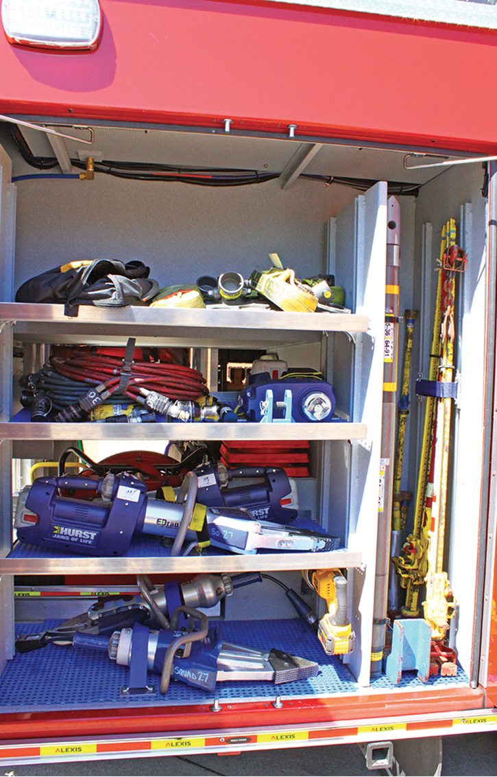 This compartment contains Squad 27's eDRAULIC rescue tools, hydraulic extrication tools, and jacks.