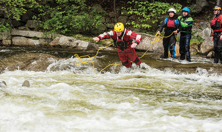 A rescuer secured by UltraLine water rescue rope made by Sterling Rope heads into the water to rescue a victim in the left center of the photo. (Photos 6-7 by Joe Klementovich.)