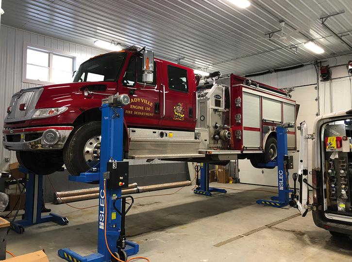 "Cadyville, New York's, four-door E-ONE/Navistar 1,250-gpm, 1,000-gallon top-mount pumper ""on the lifts"" in the Desorcie shop. The rig has shutter doors and a 40-gallon Class A foam tank."