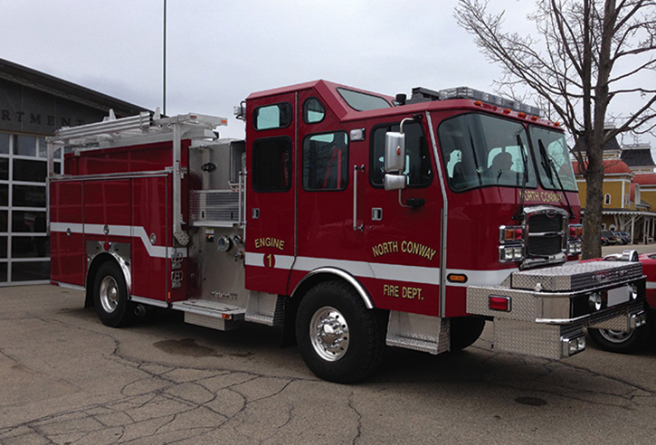 North Conway, New Hampshire, located in the center of the White Mountains, averages more than six feet of snowfall each year and runs this E-ONE Typhoon 4×4 CAFS-equipped aluminum pumper with a Waterous 1,500-gpm pump and 1,000-gallon tank. It has a two-armed ladder rack—different than the New London rig—full-height hinged doors, windows in a raised cab roof, and a unique extended front bumper design.