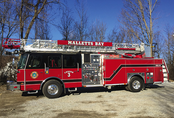 Mallets Bay, Vermont, took delivery of an E-ONE Typhoon HP 75 Side Stacker quint with a 1,500-gpm Waterous pump and 500-gallon tank. It has a prepiped ladder pipe, hinged doors, and a black-over-red paint scheme.