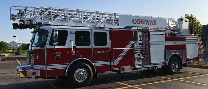 Conway, New Hampshire, runs this E-ONE Cyclone II HM 100 dual-axle quint with an aluminum aerial, 1,500-gpm pump, and 500-gallon booster tank.