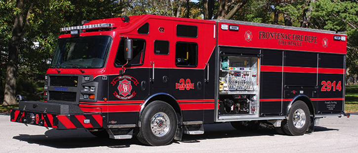 The Frontenac (MO) Fire Department runs this 1,500/750 Rosenbauer Crossfire pumper with sealed lever bank controls for pump discharges, three speedlays in a fully enclosed pump house, and a red-black-red paint scheme with graphics.