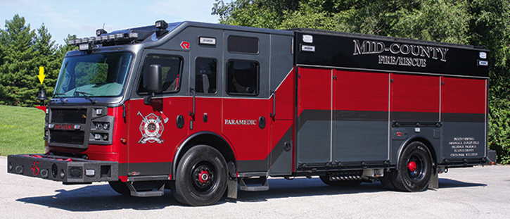 This Rosenbauer 1,500/750 Crossfire pumper operated by the Mid County (MO) Fire Protection District sports gray-red paint on the cab and black-red-gray paint on the body. Preconnects are on both front and rear bumpers. The blacked-out feature includes the bell on the cab front.