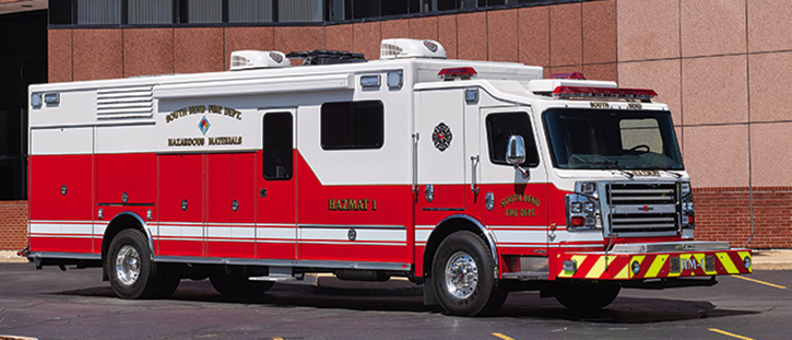 The South Bend (IN) Fire Department runs eight Rosenbauers, including this walk-in hazmat rig on a two-door custom chassis. It has hinged doors, a side entry door, a powered awning, and a light tower.
