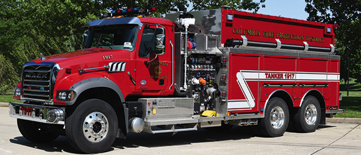 One of nine pieces operated by the Columbia (IL) Fire Protection District is this 3,000-gallon Rosenbauer pumper-tanker with a 1,500-gpm pump on a tandem Mack two-door chassis. It has an electric dump valve with a swiveling chute and a powered portable tank rack. Note the extra-long hard sleeve above the side compartments.