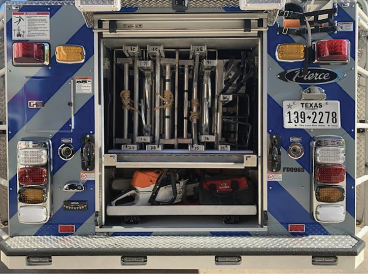 The rear compartment with chain saws and complement of ground ladders.