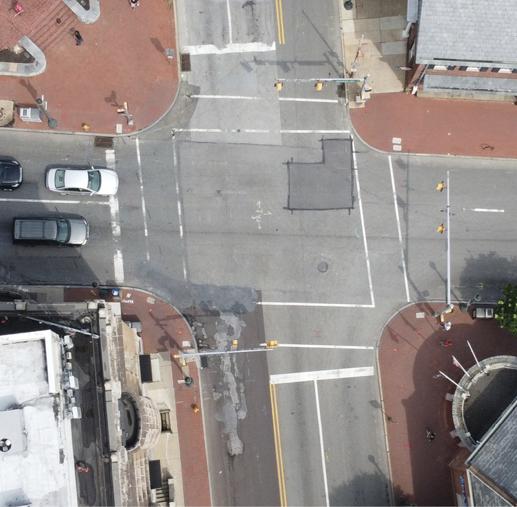 An urban intersection in West Chester, Pennsylvania. A vehicle turning right would traverse a curve radius of approximately 26 feet. This tight turn radius will result in high lateral g-force, even at low speed. Fire apparatus operators must be especially careful when turning at an intersection.