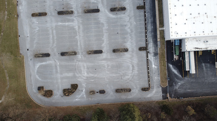 A parking lot used for fire apparatus driver training. The distance between the mulch beds is 90 feet. This results in a turning radius of 40 feet for driver training exercises. When turning a fire apparatus in such a tight circle, drivers and trainers must be especially aware of the potential to flip a rig onto its side.