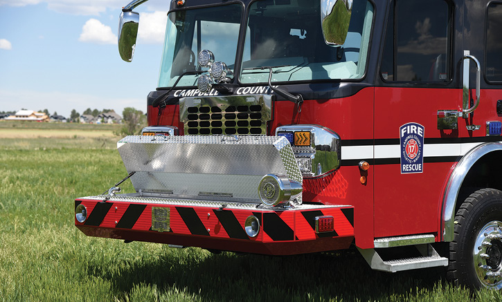 The extended front bumper holds 250 feet of 1¾-inch hose in a full-length crosslay.