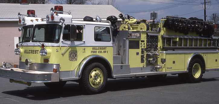 A 1976 Young-Bison quad showing a 30-foot 3-section extension on the left side. On the right side and sliding in the rear were two 35-foot 3-section ladders, two 24-foot two-section ladders, a 40-foot 3-section extension ladder, and 14-foot roof and 10-foot folding ladders. For reference, the 30-foot is 13 feet 3 inches long; the 35s are 15 feet 3 inches, and the 40-foot is almost 17 feet long. Compare a 40-year-old quad's ground ladder complement with today's typical 75-foot rear-mount quints.