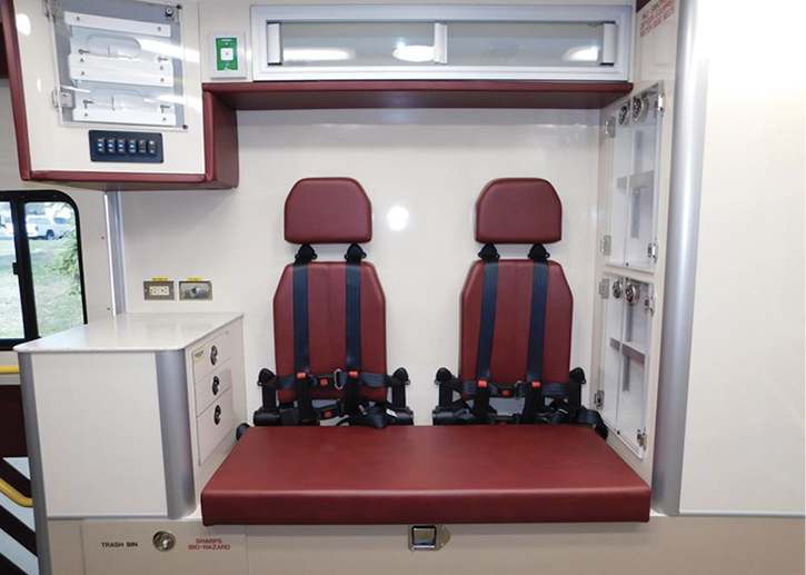 L Custom Body and Equipment Company Inc. built this double squad bench seating arrangement with six-point harnesses surrounded by its Medic in Mind design that uses all rounded corners and 45-degree angled upper cabinets.