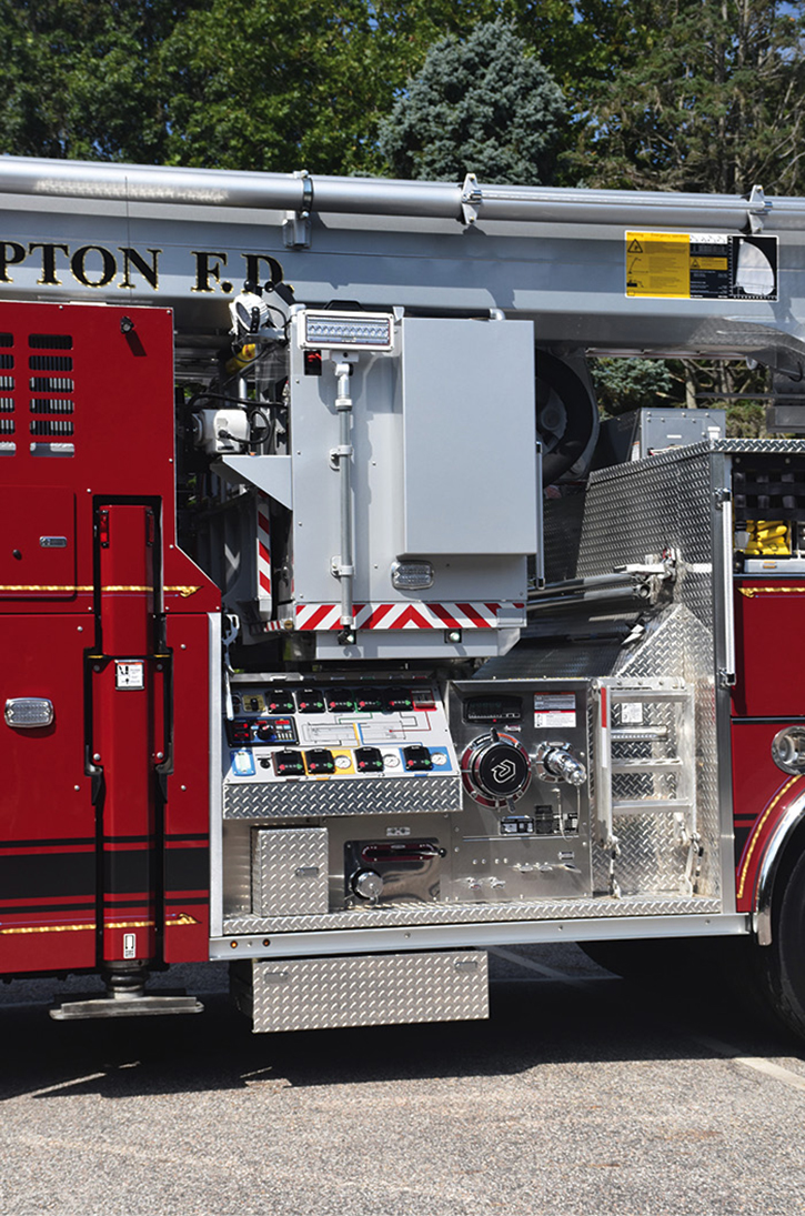 The platform basket tucked into the body above the pump panel.