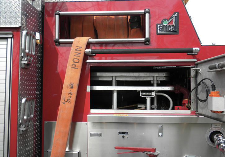Ladders extending into the pumphouse on a Smeal pumper. This rig has nonpreconnected hose on reels: 2½-inch on the curb side and 1¾-inch on the road side.