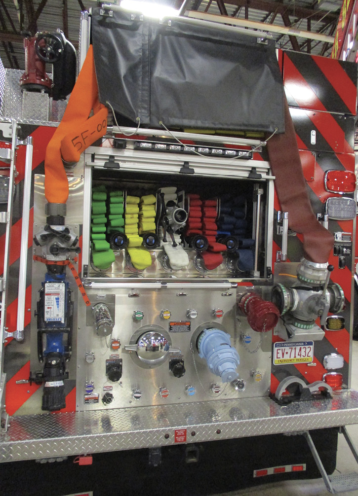 ive tray-mounted shoulder-load preconnects beneath the main bed on a rear-mount Rosenbauer pumper Kaza Fire Equipment delivered to the Lakemount (PA) Volunteer Fire Company. The preconnected ground monitor and the LDH butt with attached hydrant valve and the elasticized tie-downs for the bed covers are reachable from ground level when hooked up.