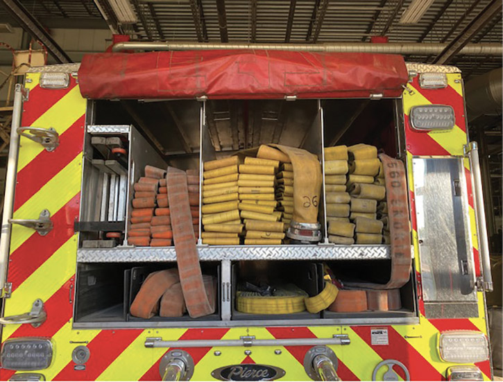 """The Skokie (IL) Fire Department started using slide-out trays beneath its main hosebed for skid loads in 2013. Several engines were similarly retrofitted in house. After delivery of a rig on order, all first-line engines, the rescue, and a reserve pumper will have them. The main bed carries 800 feet of five-inch LDH. The two outer beds carry 500 feet of three-inch and 450 feet of 2½-inch set up for reverse lays with skid loads. One tray carries three 50-foot shoulder loads of 2½-inch with a 1¼-inch smooth bore leader line tip preconnected to the 2½-inch bed. The right side trays carry two 50-foot shoulder loads of 2½-inch with a leader line wye and 100 feet of 1¾-inch. The far left tray normally carries a high-rise pack. Battalion Chief Bill Endre says, """"The unique part of our beds is all of the shoulder loads are stored 'under the main hosebed' in trays that are easy to reload. Their bottoms are 50 inches off the ground, making them accessible without climbing onto the tailboard. It reduces the chance for injury and makes for a very quick lead-out. The shoulder loads are connected to the top of the flat lay, which makes them play out smoothly while walking away or reverse laying to a hydrant. This nontraditional configuration (shoulder loads under the main bed) was dreamed up by several now-retired fire officers who took on the challenge of thinking outside the box. They, with the rest of the apparatus committee, were tasked with figuring out a way to reduce the chance of injury while speeding the deployment of the first-in hoseline."""""""