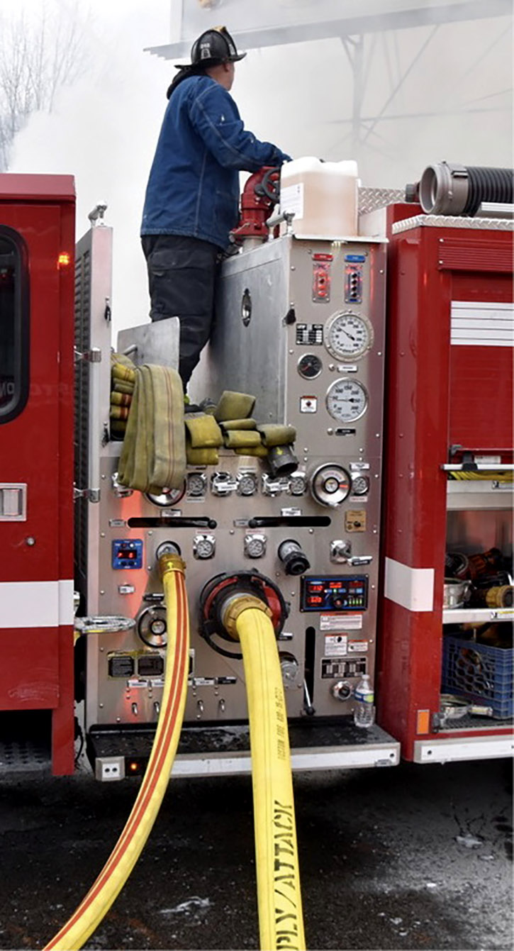 A narrow pumphouse with low crosslays standard on Boston (MA) Fire Department pumpers. The crosslay area can provide additional equipment storage.