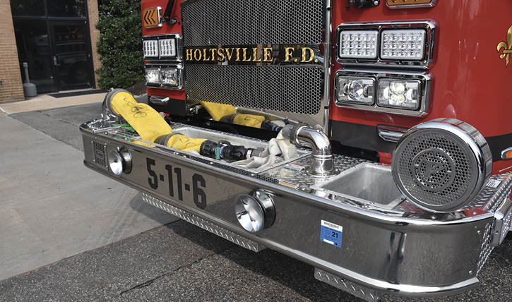 The extended front bumper with five-inch LDH hydrant hookup and 1¾-inch trash line.
