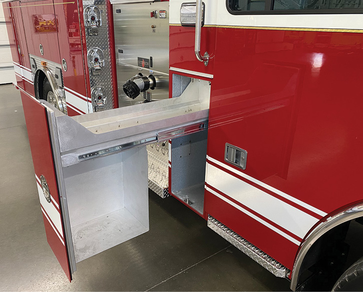 Sutphen Corp. has offered a number of options for getting turnout gear and SCBA out of apparatus cabs, such as this slide-out tray in a separate sealed compartment behind the crew cab.