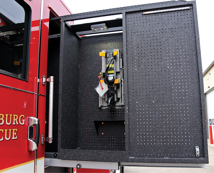 Pierce Manufacturing built this 24-inch-wide sealed compartment behind the crew cab with a slide-out tool board that holds two sets of turnout gear and two SCBA