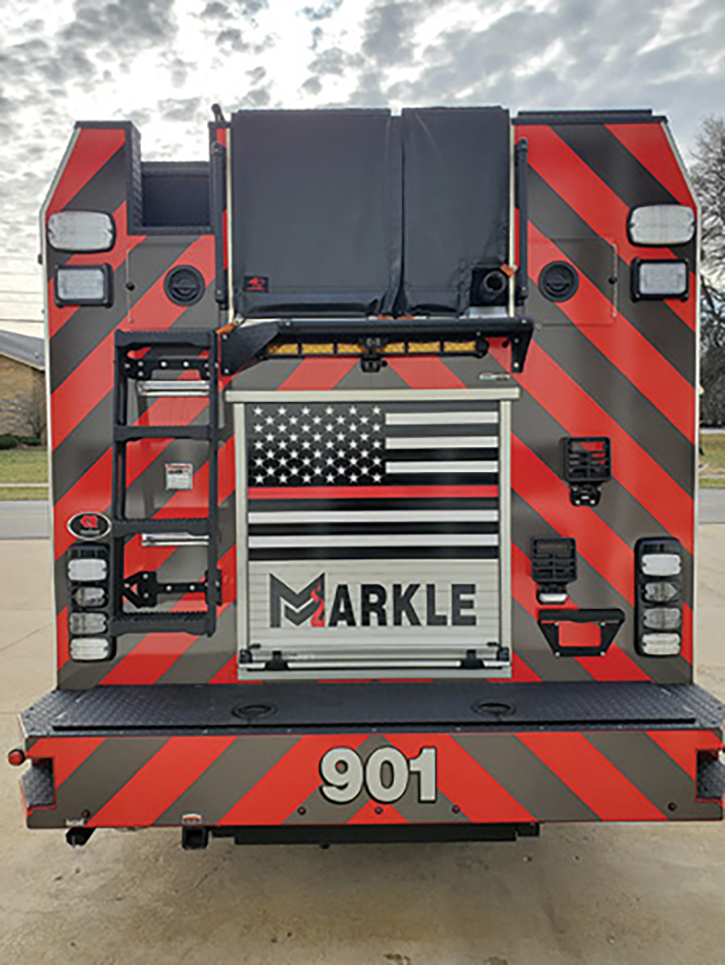 he rear features two 200-foot 1¾-inch hose crosslays in a compartment in the rear bumper and a ladder tunnel that stores ground ladders horizontally in a through-the-tunnel compartment covered by a roll-up door.