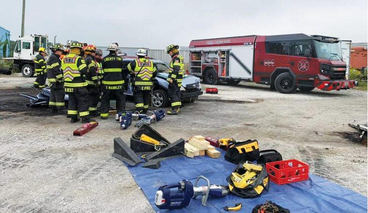 Firefighters are shown training with rescue equipment carried on the officer's side of the new rig.