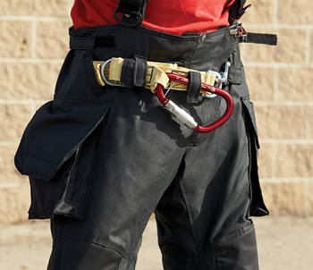 This Class II harness made by Lion is integrated in between the inner liner and outer shell of its turnout pants, which interfaces with a CMC LEVR or Escape Artist descent control device, a carabiner, a snap link, a D-ring, and 50 feet of Technora rope.