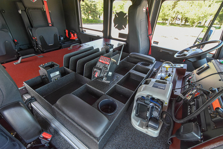 The cab of the midmount aerial platform quint is outfitted with Spartan ER's APS, and the rig has WABCO Meritor Smart Track ESC.