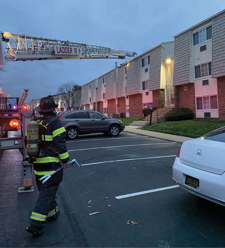 Occupied parking spots in apartment complexes create positioning issues for truck company apparatus.
