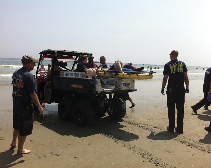 Wells (ME) Fire Department personnel use a UTV carrying a MEDLITE MTD-103 unit to evacuate a patient from the beach