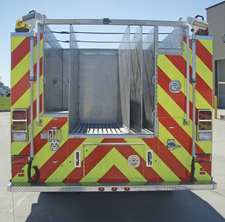 Toyne built this pumper with a hosebed at frame height, which required very deep dividers.