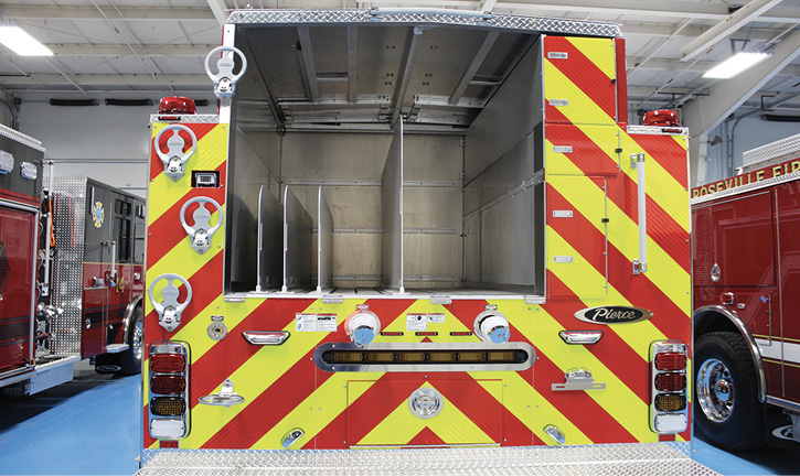 Pierce Manufacturing built this low-hosebed pumper with dividers for three handlines and two supply line storage areas, along with two 2½-inch rear discharges.