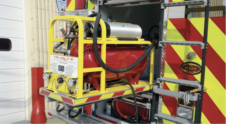 This TRI-MAX 30 CAFS stored-air energy system made by Kingsway Industries is installed on a slide-out tray in the rear compartment of a fire apparatus.