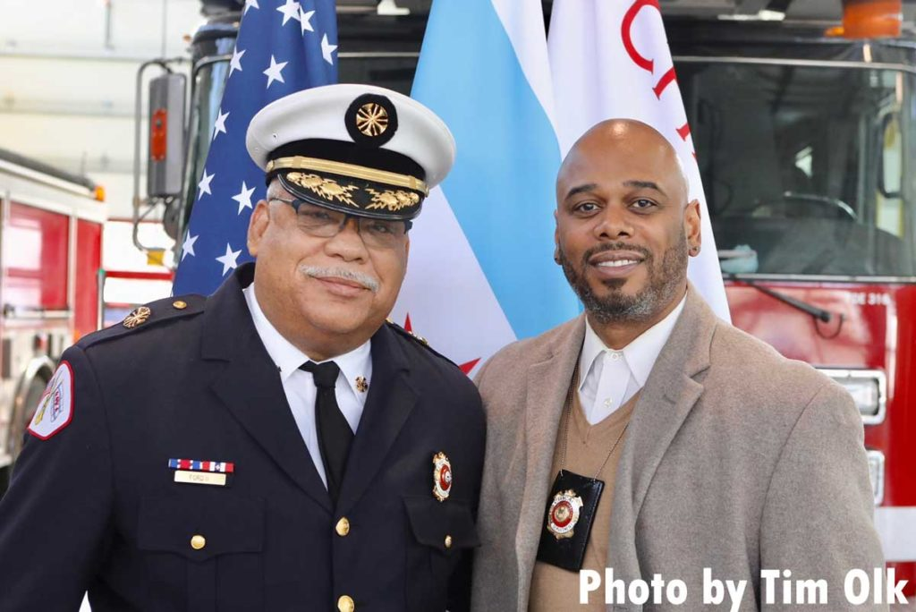 Chicago fire commissioner and dignitary at ribbon cutting for Chicago Fire Department Engine Company 115
