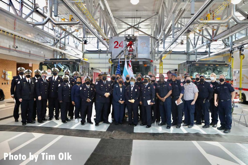 Chicago fire officials and dignitaries at ribbon cutting for Chicago Fire Department Engine Company 115