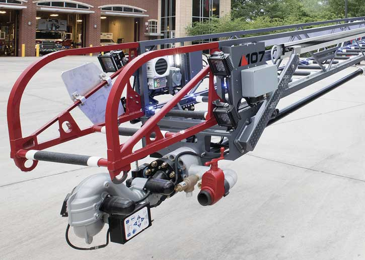 Equipment on the tip of this Pierce Ascendant 107-foot aerial ladder includes four LED lighting units, ladder tip controls, and a chain saw scabbard.